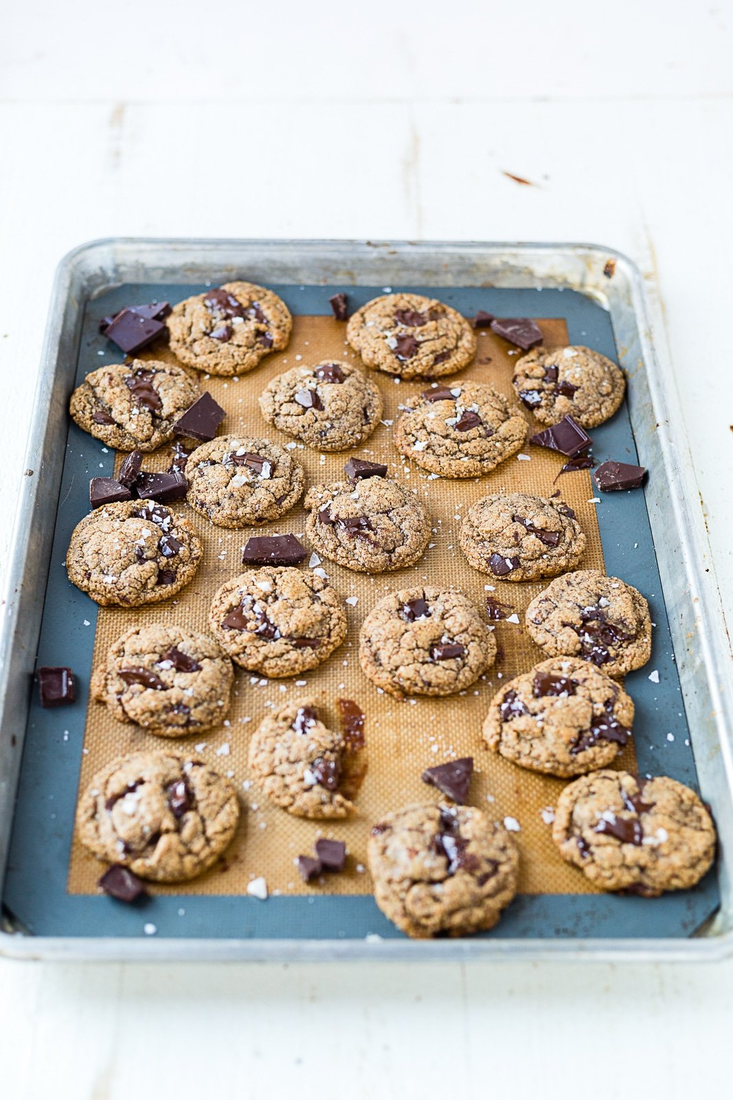 keto almond butter cookies on a cookie sheet cooling