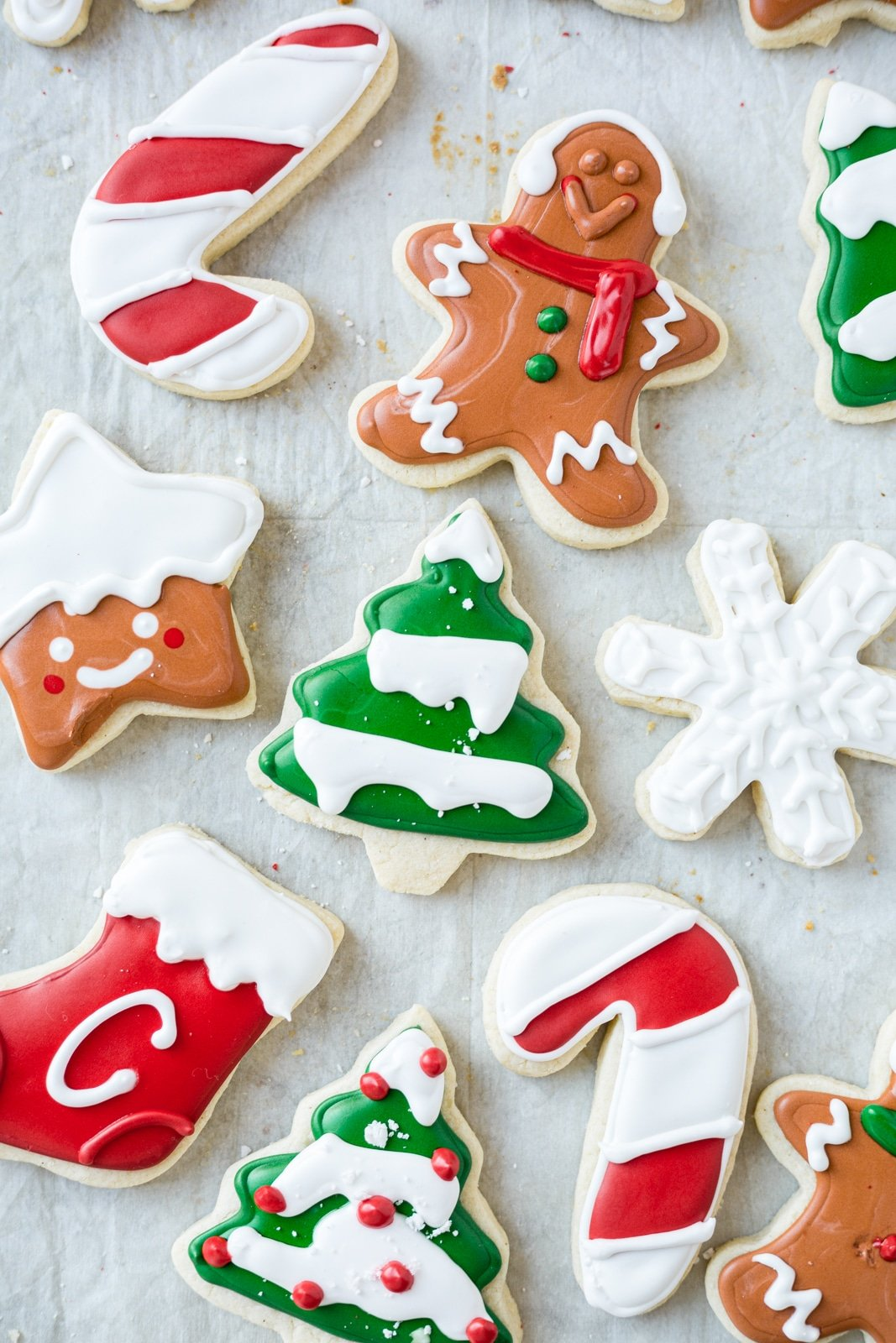 gluten free dairy free sugar cookies iced in the shape of trees, gingerbread men and stars with royal icing