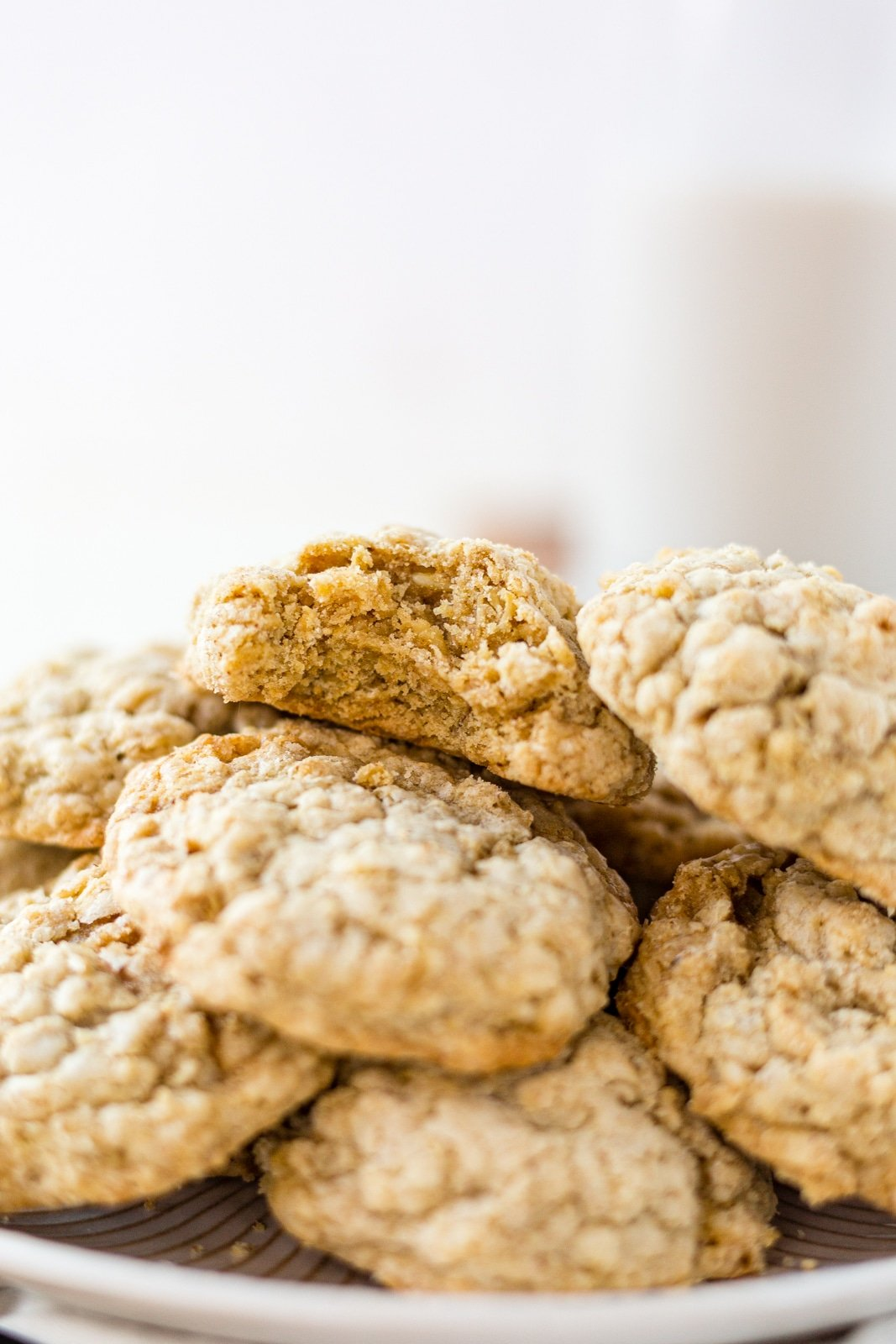 a pile of brown butter oatmeal cookies on a white plate