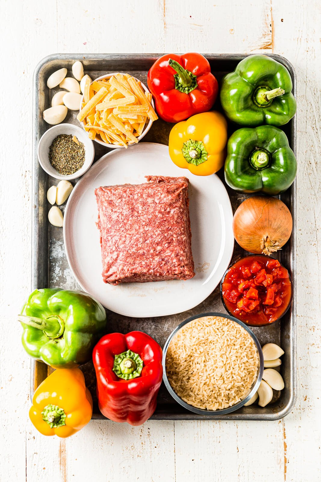 Ingredients for air fryer stuffed peppers arranged on a sheet pan before cooking