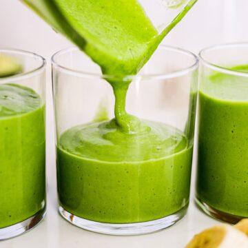 avocado smoothie pouring into a glass