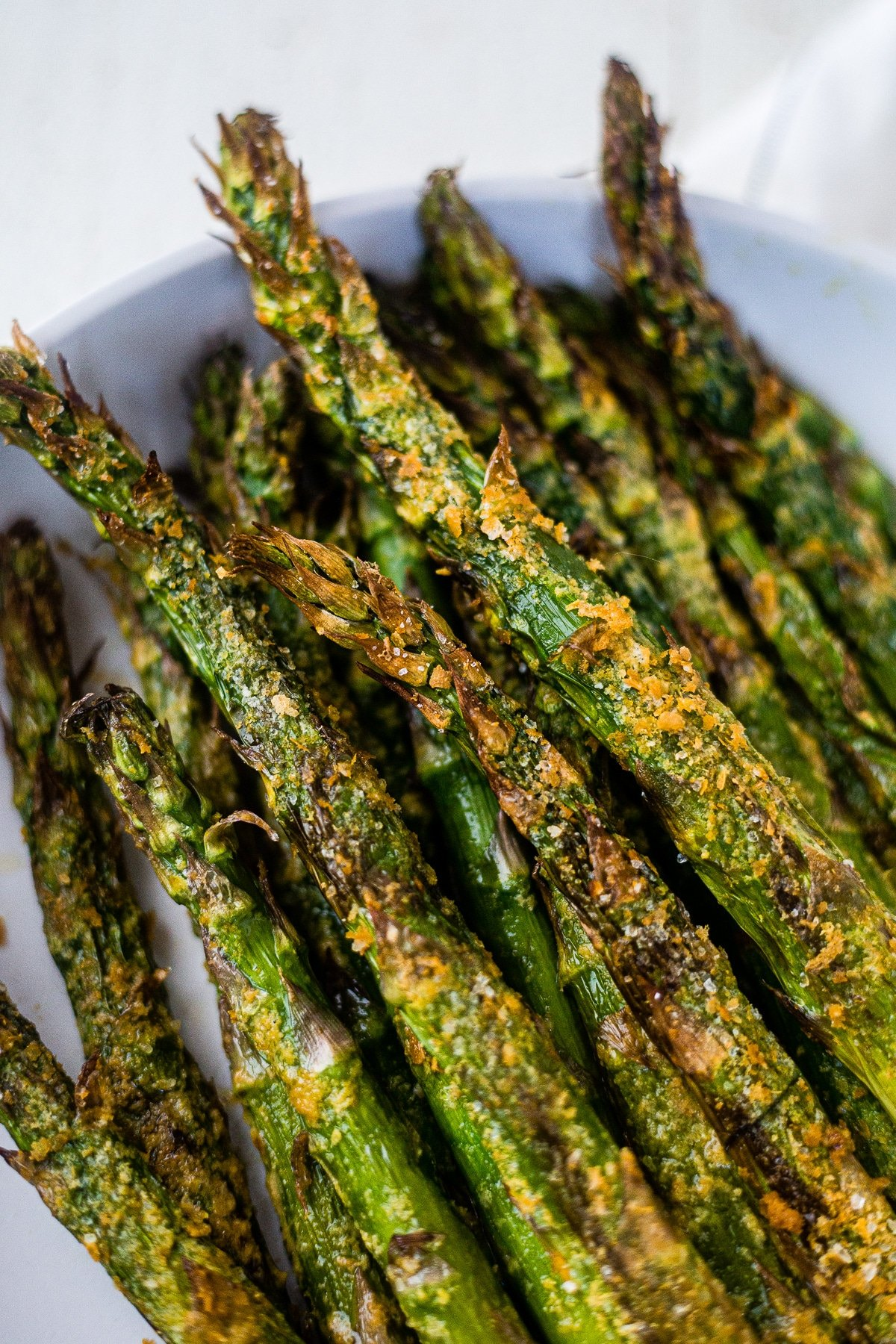 close up of air fryer asparagus coated in avocado oil, salt and nutritional yeast