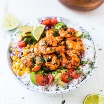 fiesta lime shrimp bowl in a white bowl topped with cilantro and lime juice
