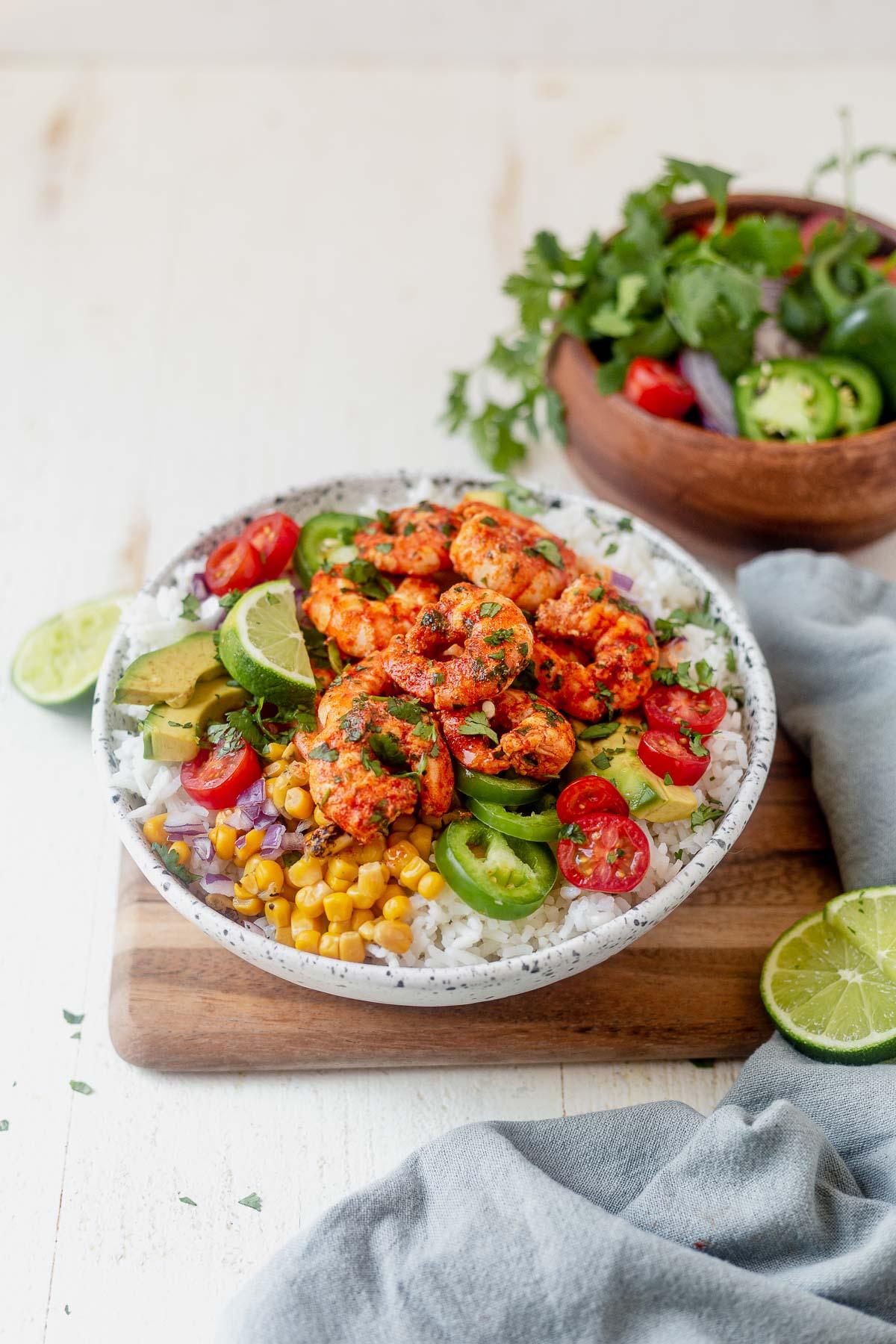 shrimp bowl with cilantro lime rice, corn, tomatoes, jalapeno and cilantro