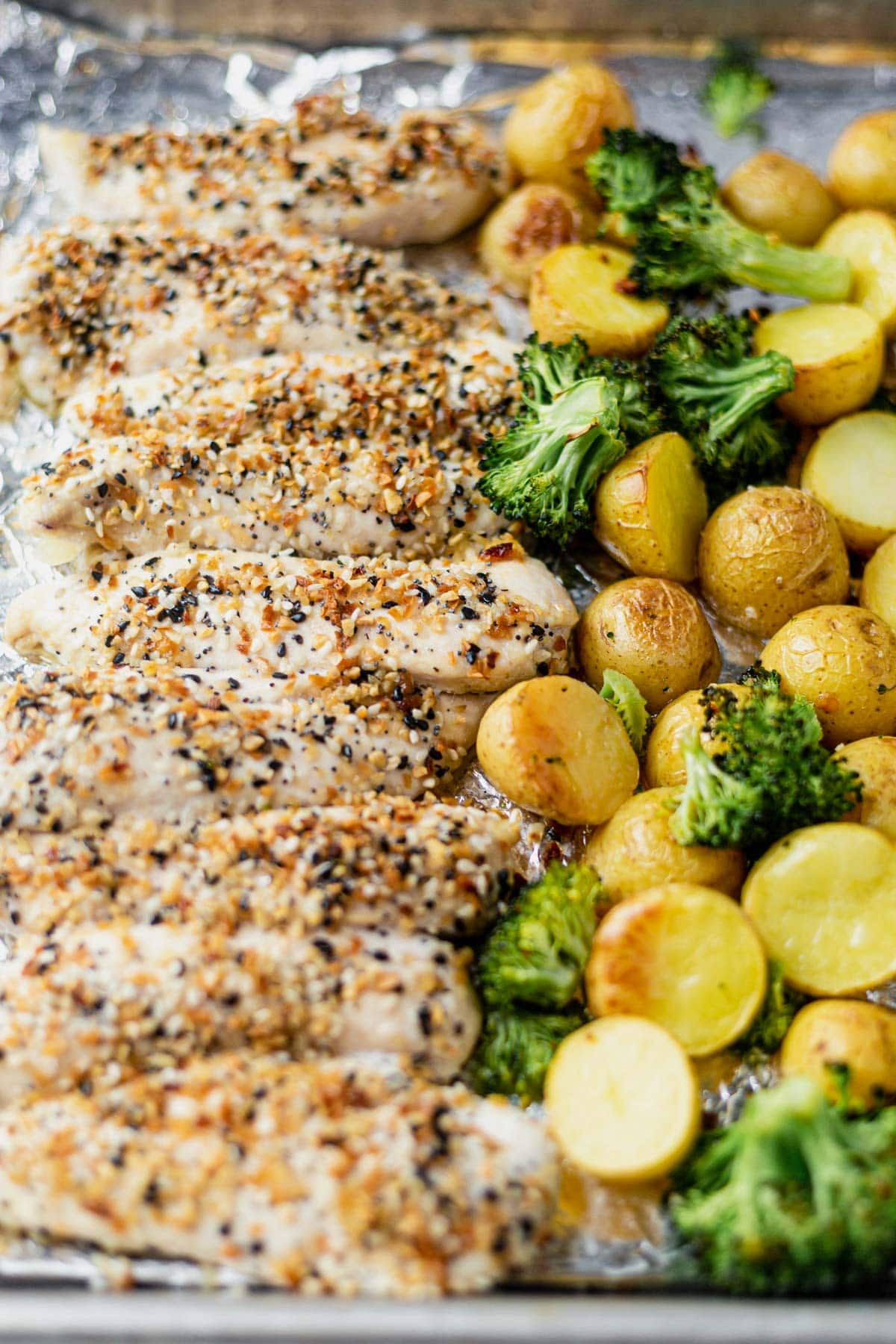 everything but the bagel chicken on a sheet pan with roasted potatoes and broccoli