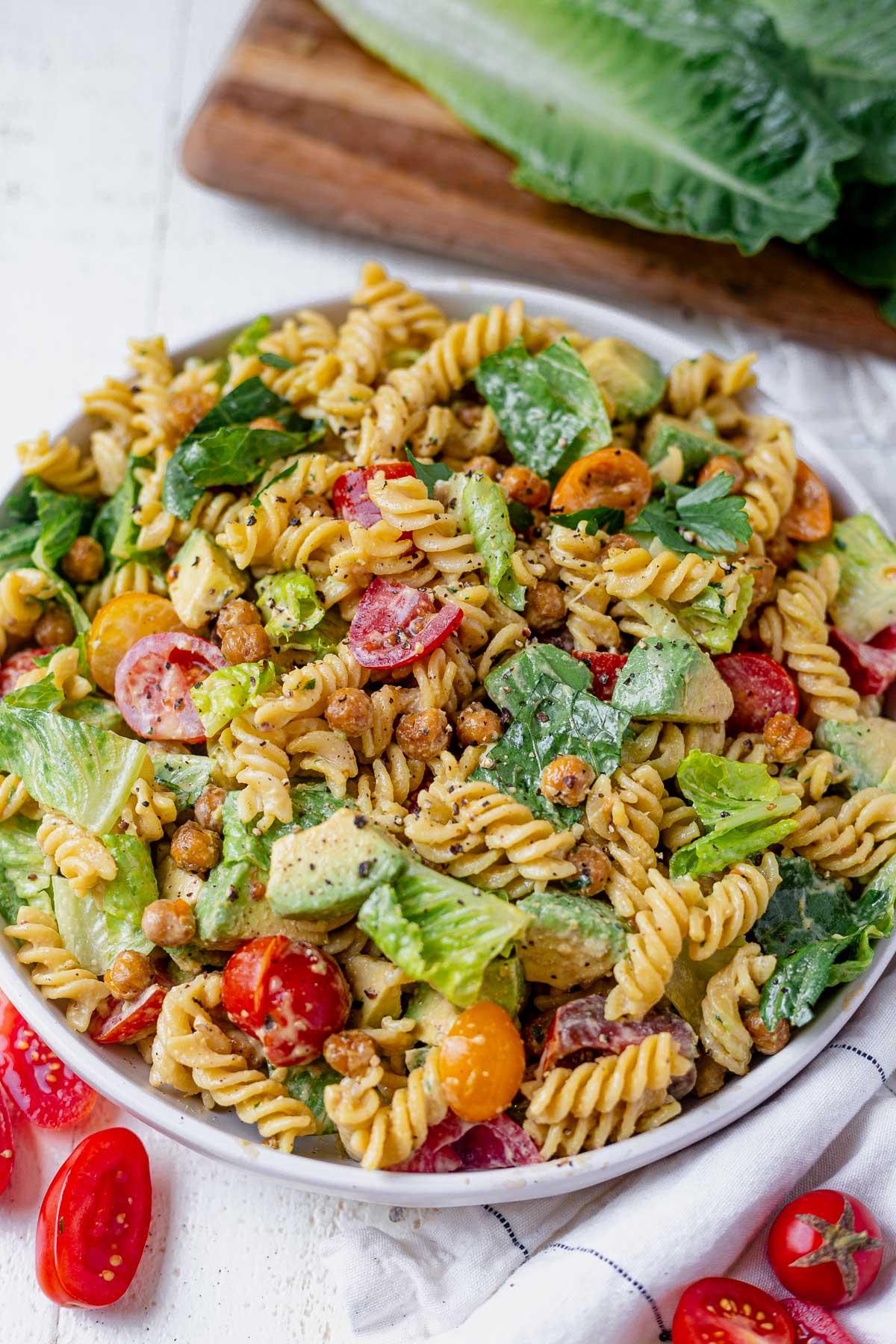 caesar pasta salad with rotini, lettuce, tomato and chickpeas