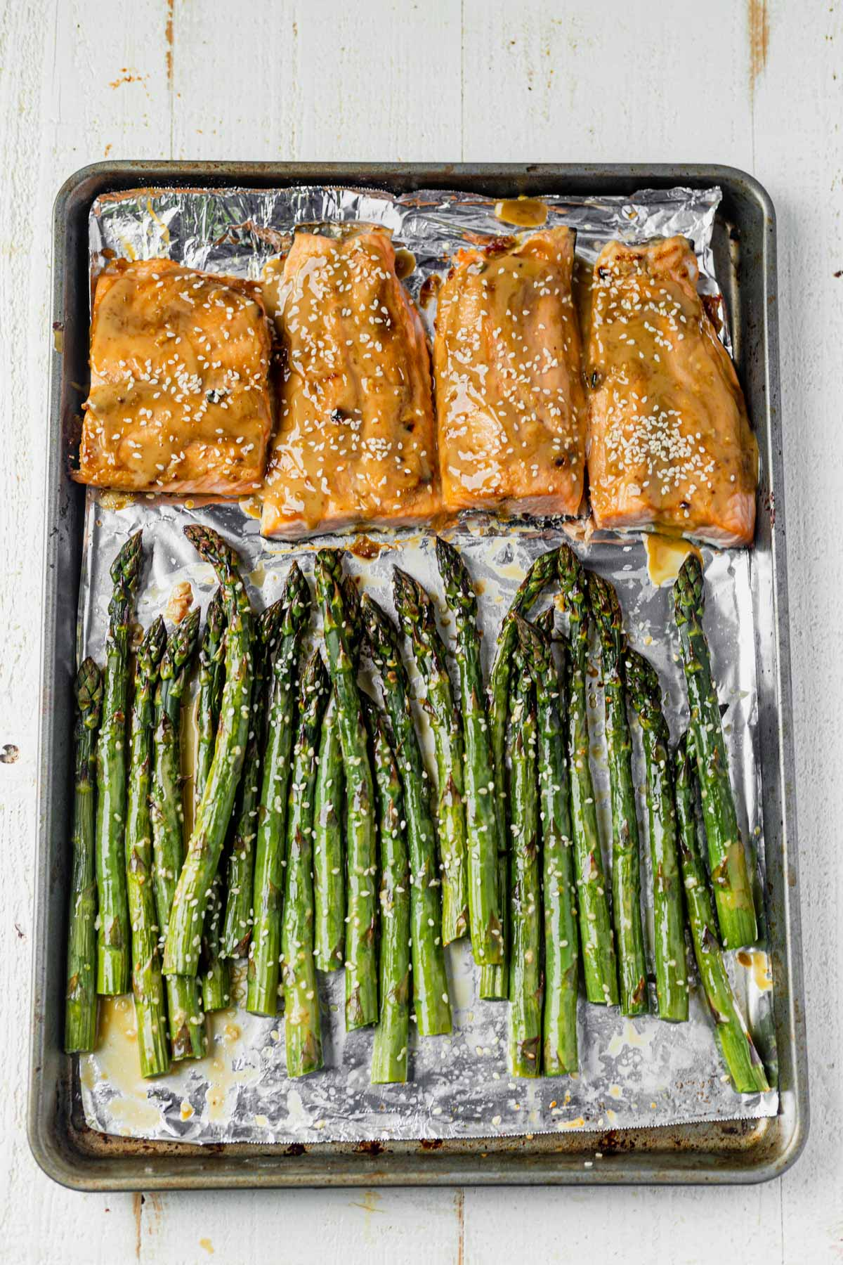 tahini ginger salmon on a sheet pan with sesame roasted asparagus
