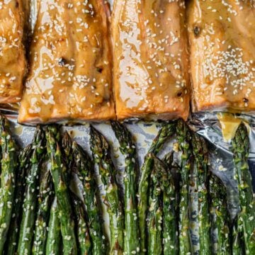 ginger salmon on a sheet pan with roasted sesame asparagus
