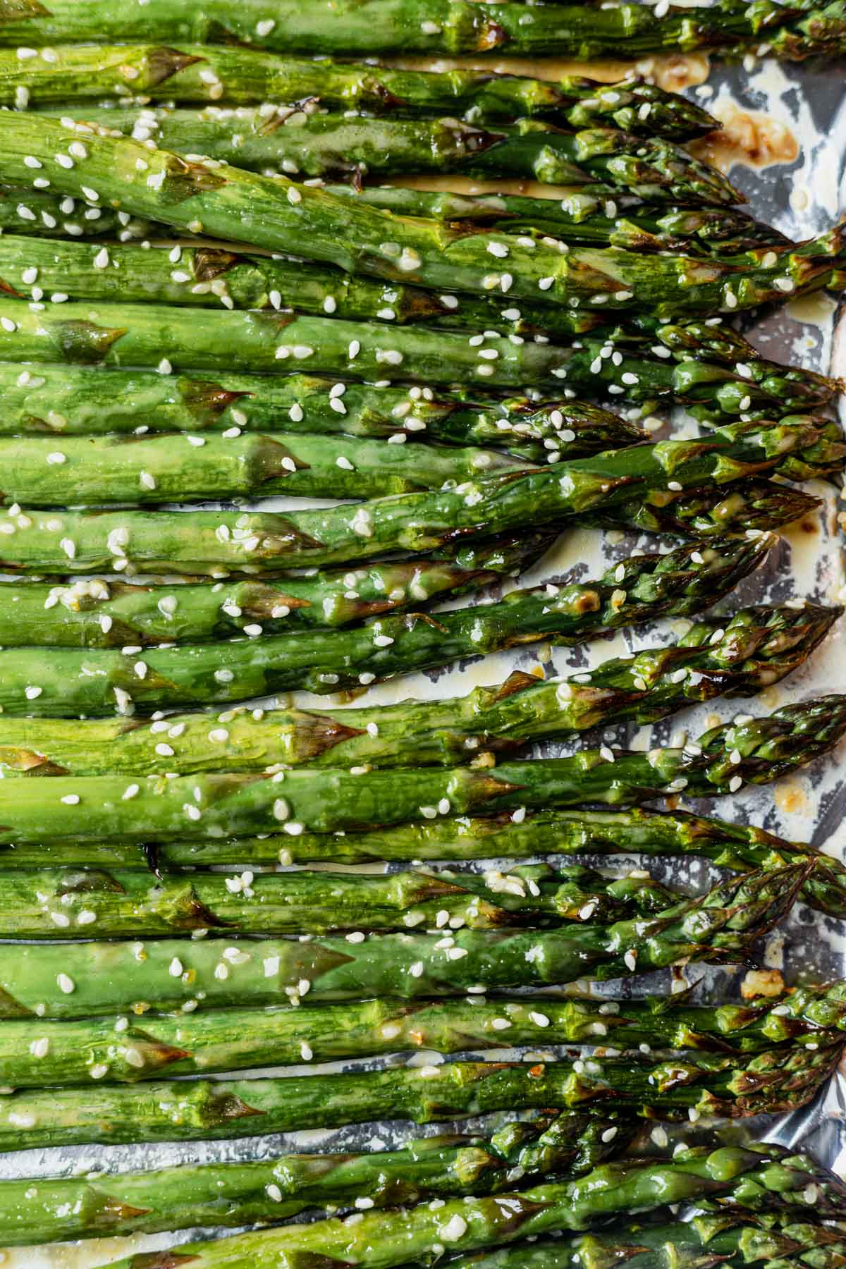 roasted sesame asparagus on a sheet pan with salmon