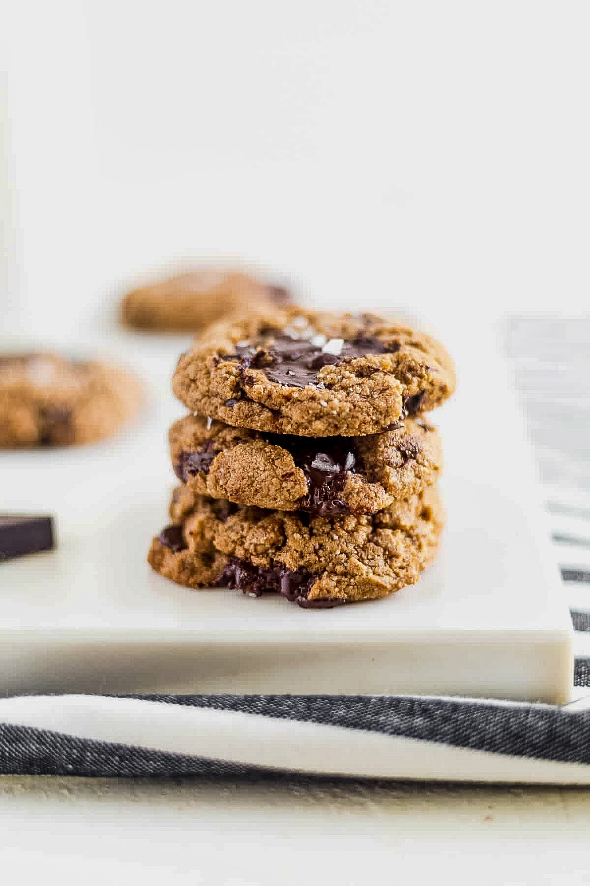 three coconut flour chocolate chip cookies stacked on top of each other
