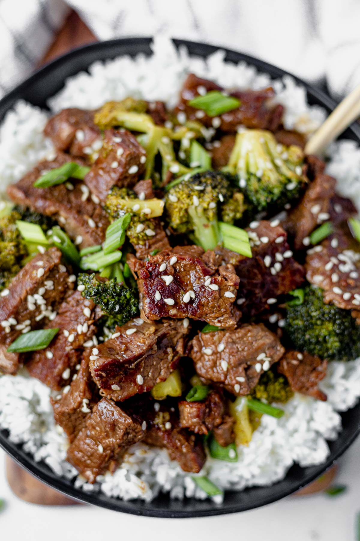 instant pot mongolian beef and broccoli over a bowl of rice