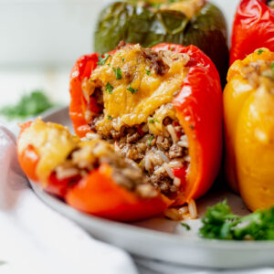 healthy air fryer stuffed pepper on a plate with melted cheese