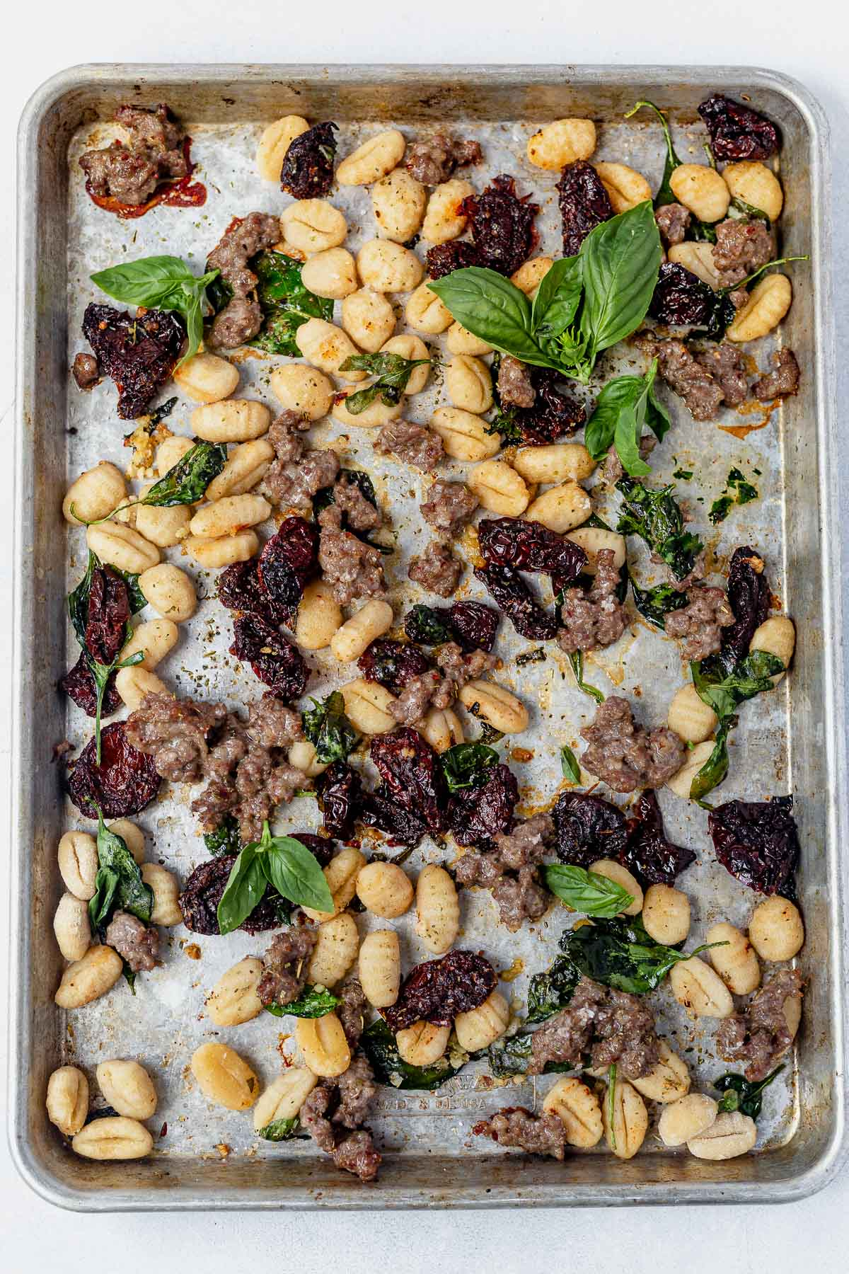 gnocchi, sausage and sun dried tomatoes all cooked on one sheet pan