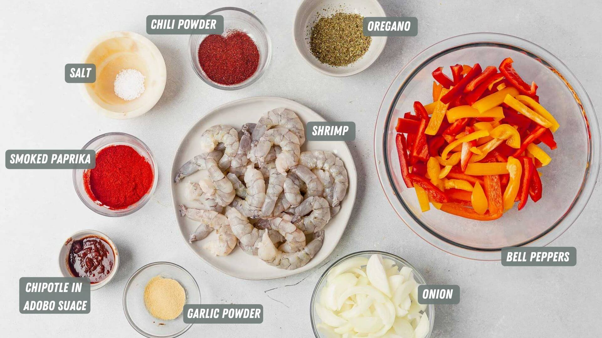shrimp fajita ingredients measured out on a table