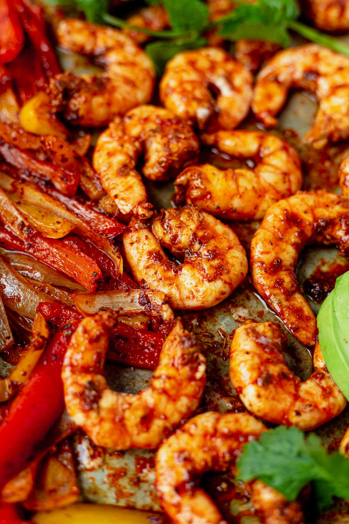 shrimp fajitas cooked on a sheet pan with fresh cilantro