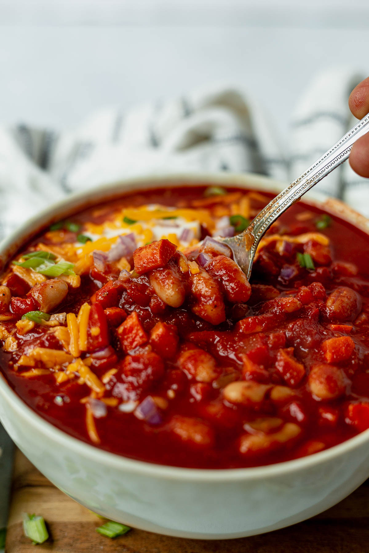 spoon scooping out a bite of slow cooker vegetarian chili