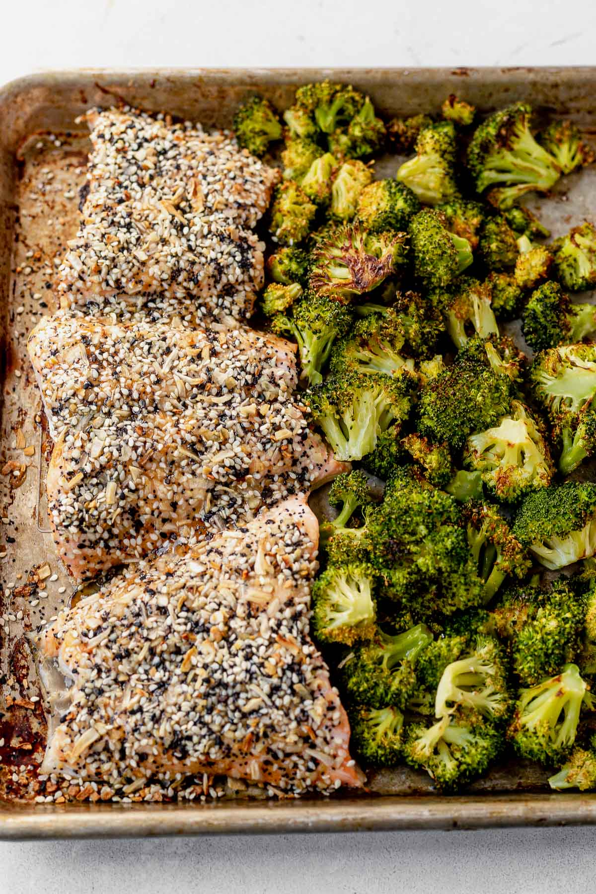 everything bagel salmon and roasted broccoli on a sheet pan
